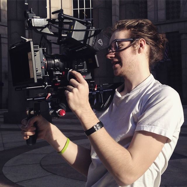 A picture of Dean with a C100 shoulder rig.
